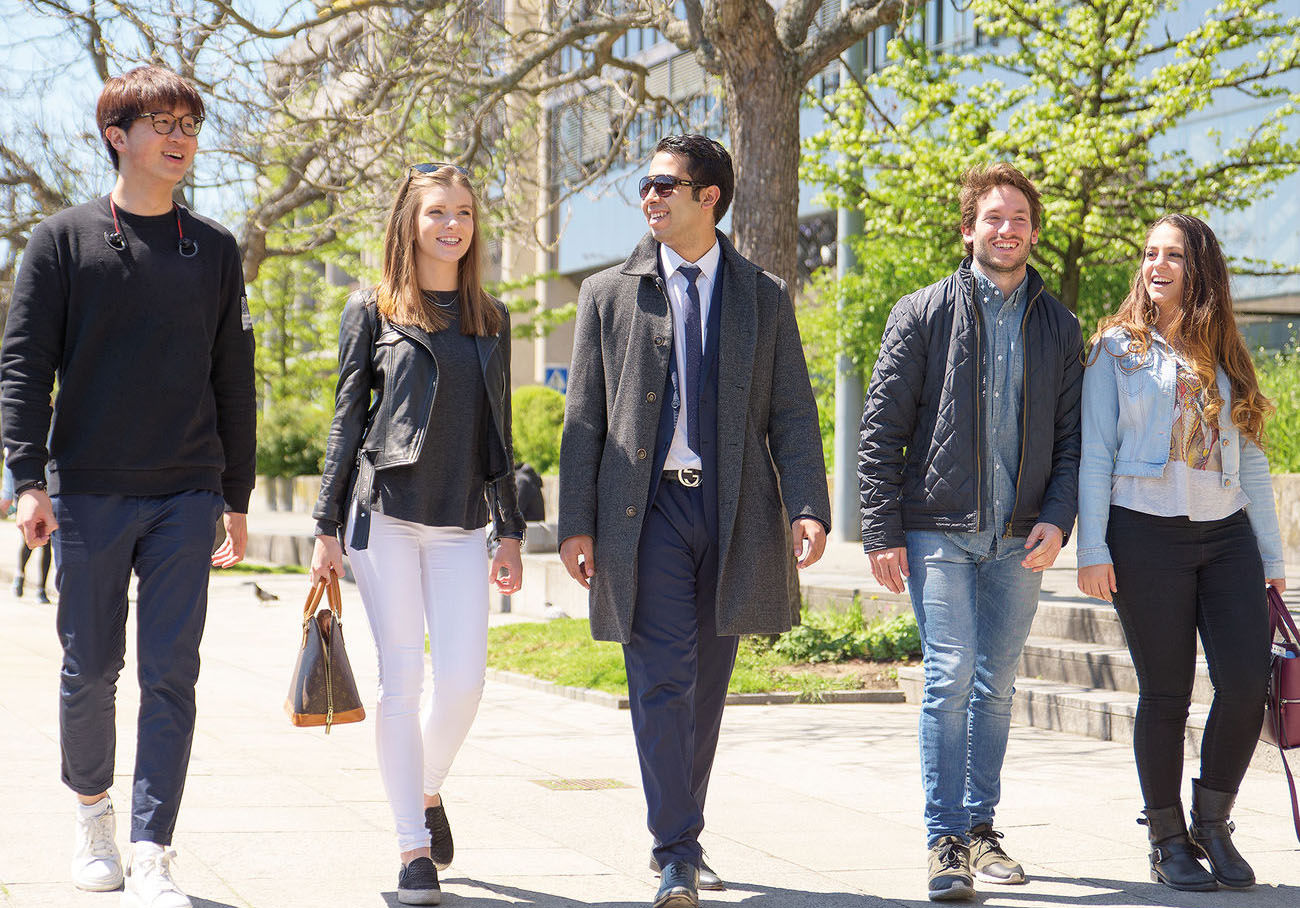 Happy students walking in Geneva