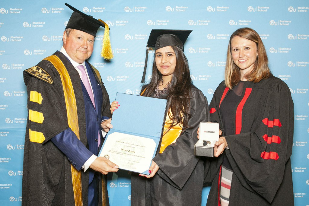 Joshi receiving her award for the highest graduate GPA, Switzerland, 2015